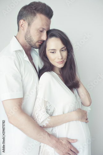 Plexiglas womenART Handsome man hugging his pregnant wife