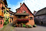 Colorful timbered houses with flowers in the Alsatian town of Eguisheim, France