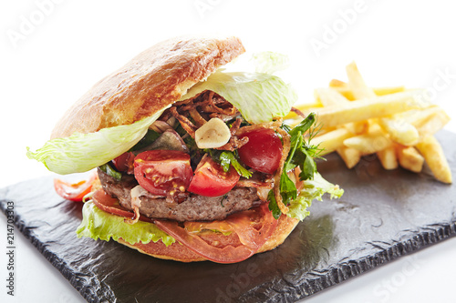 Fresh Beef Burger with Bacon, Fried Onions and French Fries Garnish - 214703303
