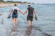 lovers walk in the sea coast