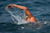 Man swimmer swimming crawl in blue sea,training for triathlon