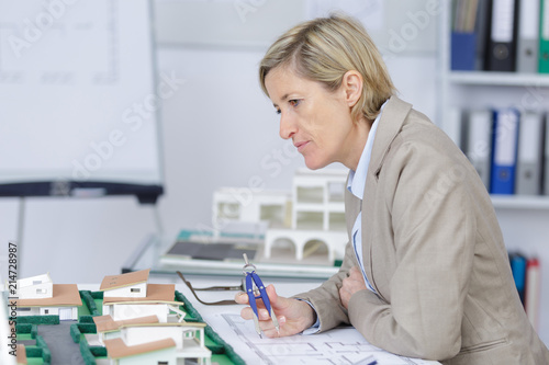 Foto Murales pensive experienced female architect at work in her office