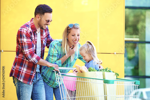 Leinwandbild Motiv Family Enjoying Shopping