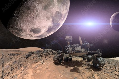 Curiosity Mars Rover exploring the surface of red planet. Elements of this image furnished by NASA. - 214777347