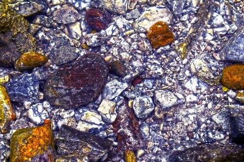 Aluminium Stenen The texture of the stone. Rocky shore. Stone wall. Concrete wall. Stone surface. Granite. Textured concrete.Colorful pebbles. Relief surface. Multi-colored stones