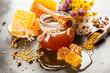 Leinwanddruck Bild - Honey jar and dipper