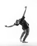Young beautiful dancer is posing in studio - 214794506