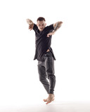 Young beautiful dancer is posing in studio - 214794525