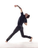 Young beautiful dancer is posing in studio - 214794562