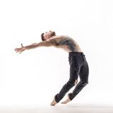 Young beautiful dancer is posing in studio - 214794569
