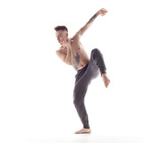 Young beautiful dancer is posing in studio - 214794710