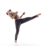 Young beautiful dancer is posing in studio - 214794731