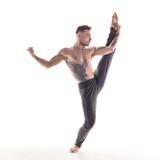 Young beautiful dancer is posing in studio - 214794739
