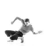 Young beautiful dancer is posing in studio - 214794777