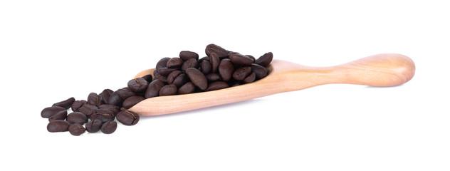 coffee bean in wooden spoon on white background. © SIRICHAYAPAT
