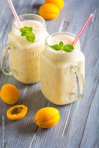 Canvas Milkshake smoothies apricot yogurt delicate wooden background