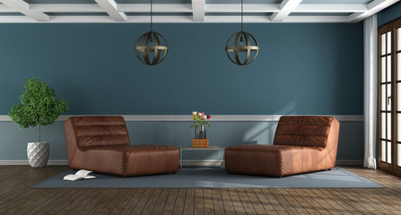 Blue living room with chase lounges © archideaphoto