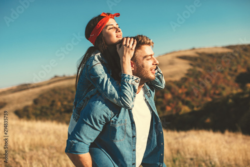 Foto Murales Happy young couple enjoys a sunny day in nature