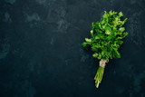 Fresh parsley. Organic food. On a black background. Top view. Free space for text. - 214836583