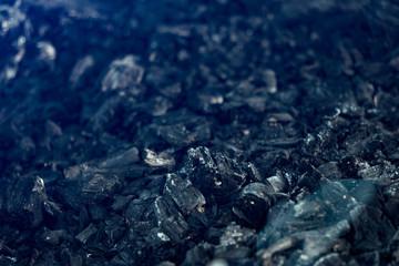 Charcoal, burnt out bonfire, black background texture