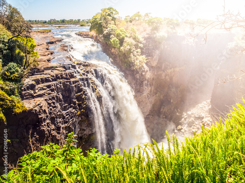 Victoria Falls on Zambezi River. Dry season. Border between Zimbabwe and Zambia, Africa. - 214856541