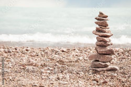 Plexiglas Zen Stenen stack of stones in the beach