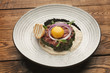 Raw veal tartare with sauce, quail egg and crouton - 214935387