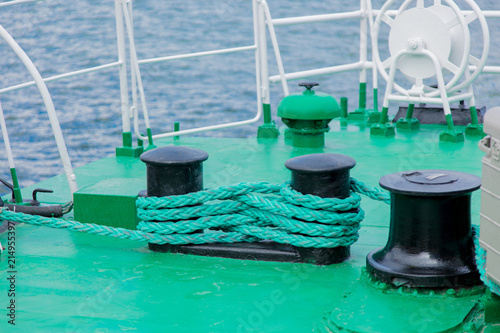 Green ship rope on a ship. Close-up view