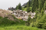 Building rubble from large stones lie in the forest - 214959173