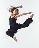 Beuatiful female dancer. Studio background. - 214983542