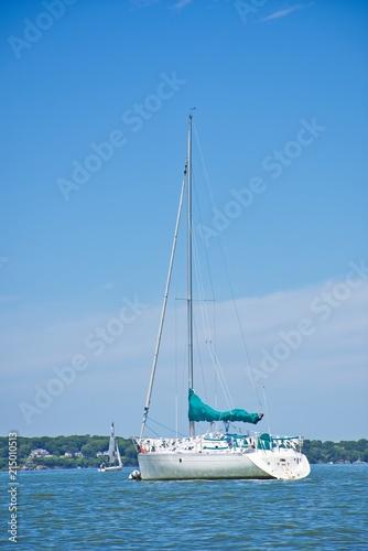 Canvas Zeilen Sailboat at Anchor in a Summer Setting - Blue Sky, Ocean, Bay - Nautical Themes.