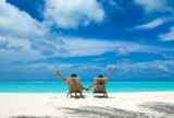 Couple on a tropical beach at Maldives - 215040501