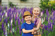 Fun and friendly children in a field of flowers