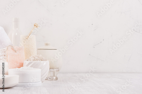Luxury organic body and skin care spa light cosmetics collection and natural bath accessories on white wood background.