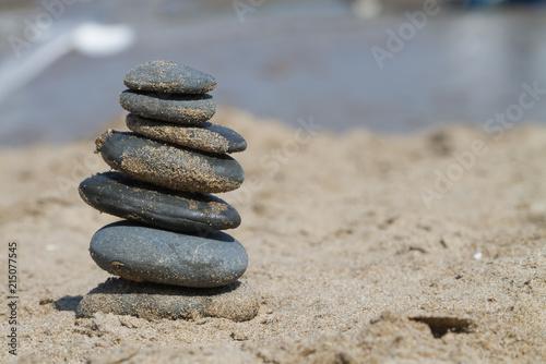 Plexiglas Zen Stenen Stacked Stones on the Sand at a Beach