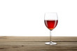 red wineglass on a wooden table isoalted on white background with clipping pat and copy space