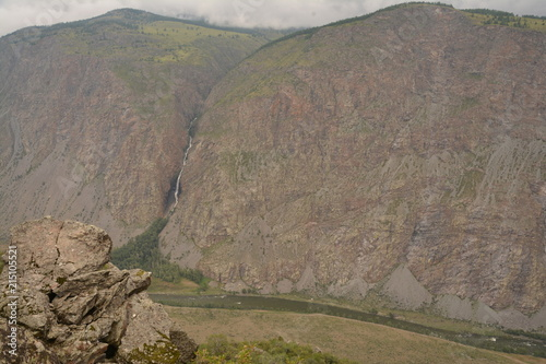 Foto Spatwand Cappuccino nature landscape landscape mountains valley hills rocks cave water waterfall stream river stream rock stone sky grass trees green blue white tourism excursions Russia