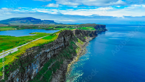 Foto Spatwand Grijs Aerial view over the green coastline and cliffs on the Isle of Skye in Scotland