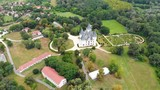 Drone footage of a neogothic and romantic castle with an english garden in Hungary. - 215140997