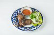 meat in a beautiful plate with lettuce and onion