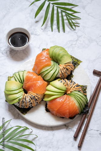 Foto Spatwand Sushi bar Sushi donuts with salmon avocado and cucumber