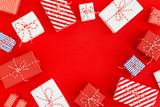Gift boxes on a red background. Christmas, holiday backdrop.