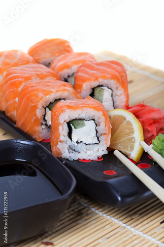 Canvas Sushi bar Salmon sushi rolls on a wooden background