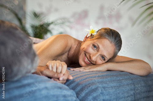 Leinwanddruck Bild Smiling woman at spa with husband