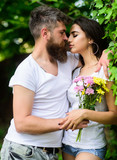 Man bearded hipster hugs gorgeous girlfriend. Couple love romantic date nature park background. Love relations romantic feelings. Gentle kiss. Couple in love going to kiss. Pleasant romantic kiss