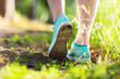Leinwandbild Motiv Young woman run in summer the forest in sunset lights