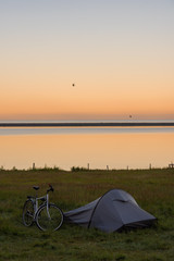 Touristic camp with bicycle and sunrise in summer ,Iceland.