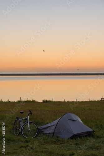 Foto Murales Touristic camp with bicycle and sunrise in summer ,Iceland.