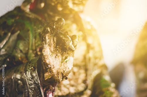 Foto Spatwand Boeddha Gilding leaf on buddha statue, religion belives