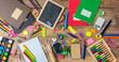 Leinwandbild Motiv Back to school. School supplies on wooden background, top view